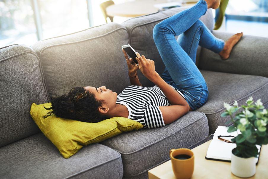 woman scrolling through ads on social media