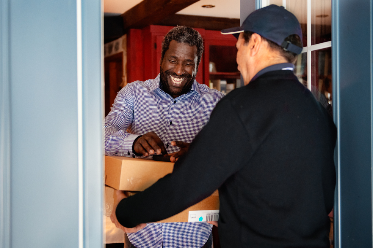 man receiving a package he ordered online on time for the holidays
