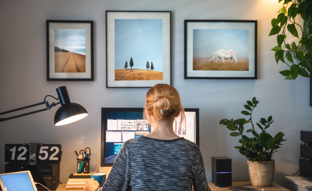 Dropshipper working on computer in her home office