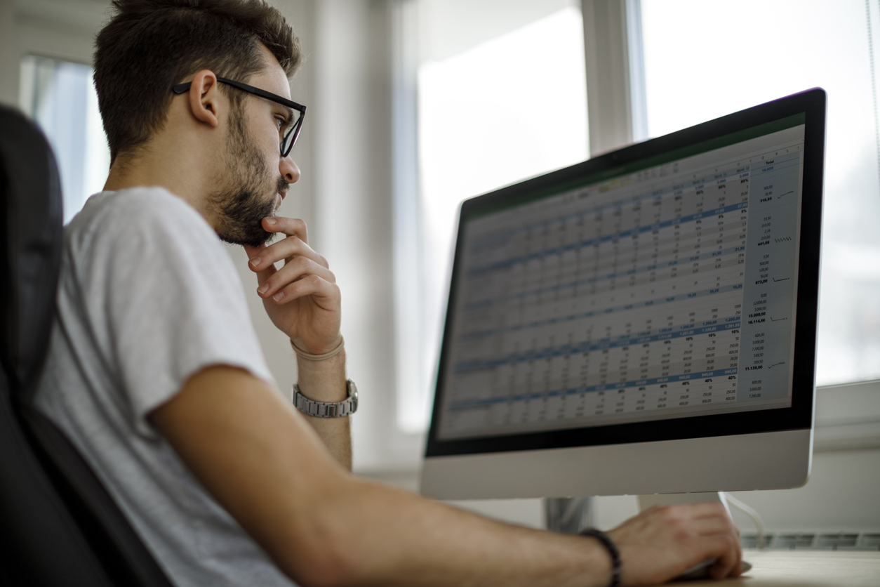 Dropshipper analyzing spreadsheets to find his gross profit margins